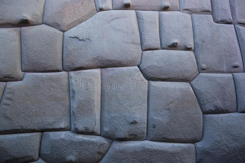 Famous Inca angled stone in Hatun Rumiyoc wall, an archeological artefact in Cuzco, Peru. It was part of a stone wall of an Inca palace, and is considered to stock image
