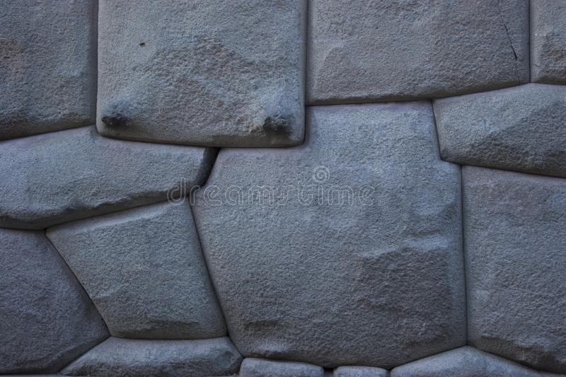 Famous Inca angled stone in Hatun Rumiyoc wall, an archeological artefact in Cuzco, Peru. It was part of a stone wall of an Inca palace, and is considered to royalty free stock photos