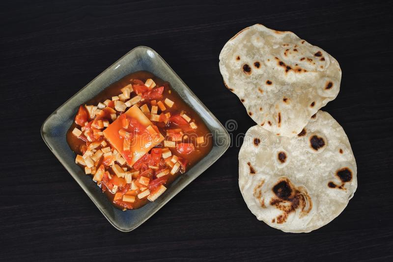 Famous Indian dish: paneer butter masala spicy curry royalty free stock photography