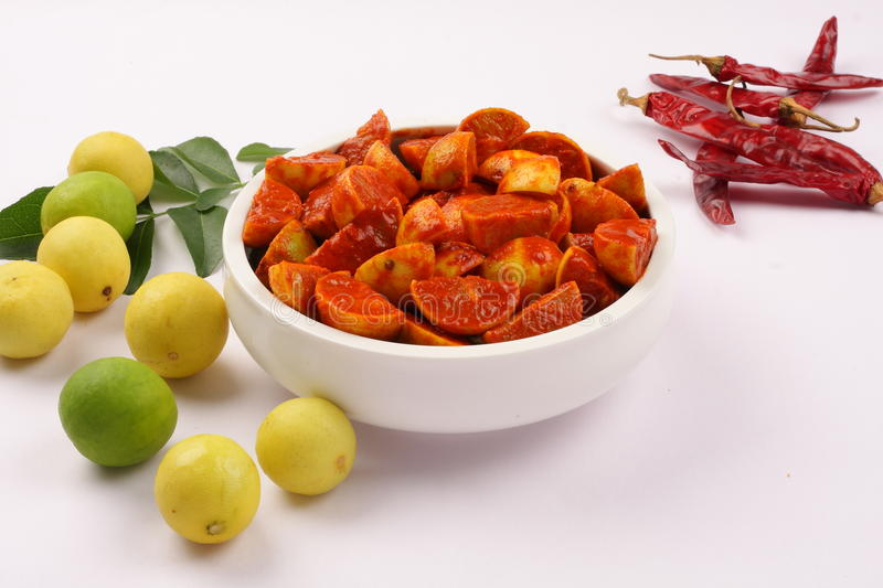 Famous Indian lime pickle. Served with fresh lime and spices stock photo