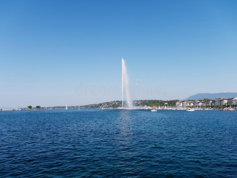 Famous Jet d`Eau fountain of the Geneva lake on a sunny day in Switzerland. royalty free stock photography