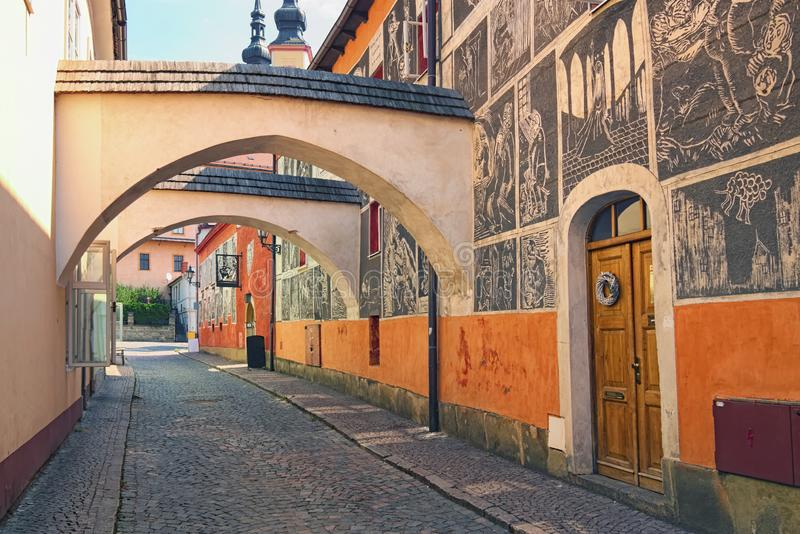 Famous Josef Vachala street. Colorful narrow street with archway and black and white pictures in the wall. Litomysl,Czech Republic. Famous Josef Vachala street stock photography