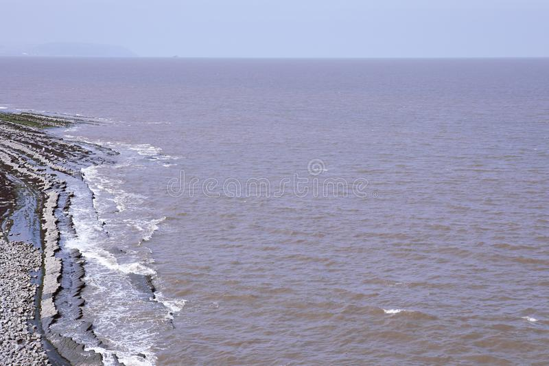 Famous Kilve beach in Somerset England. Summer day. English coast landscape. Horizon line. UK. Rock formations on scenic beach. Horizon line. UK. Rock formations stock images