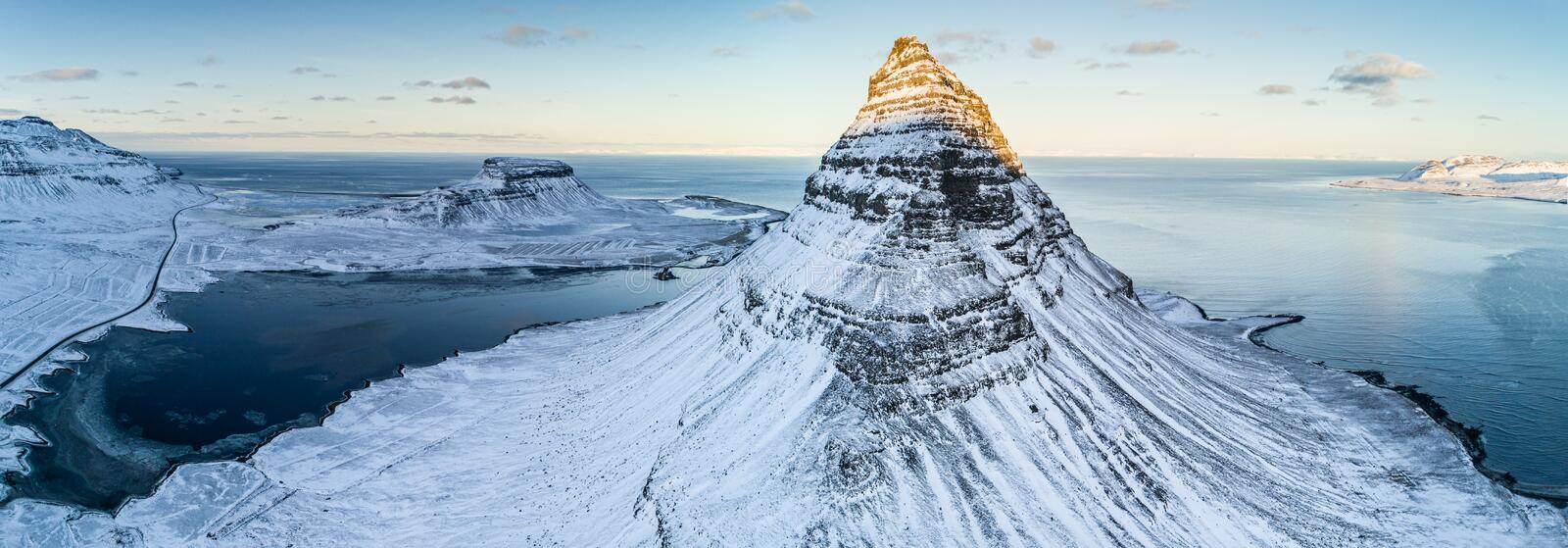Famous Kirkjufell mountain in winter, Iceland. Famous Kirkjufell waterfall with mountain in winter, Iceland, Europe stock images