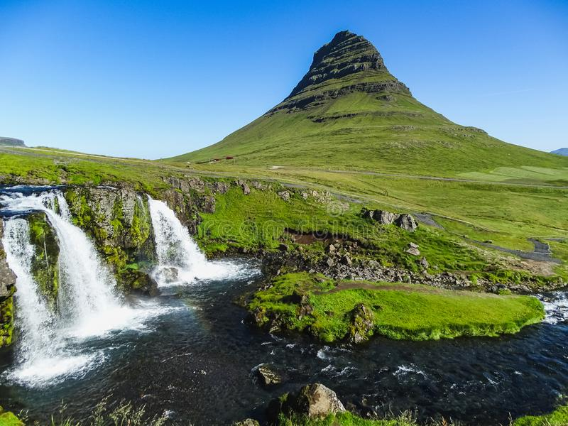 The famous kirkjufellsfoss waterfall with kirkjufell mountain royalty free stock photography