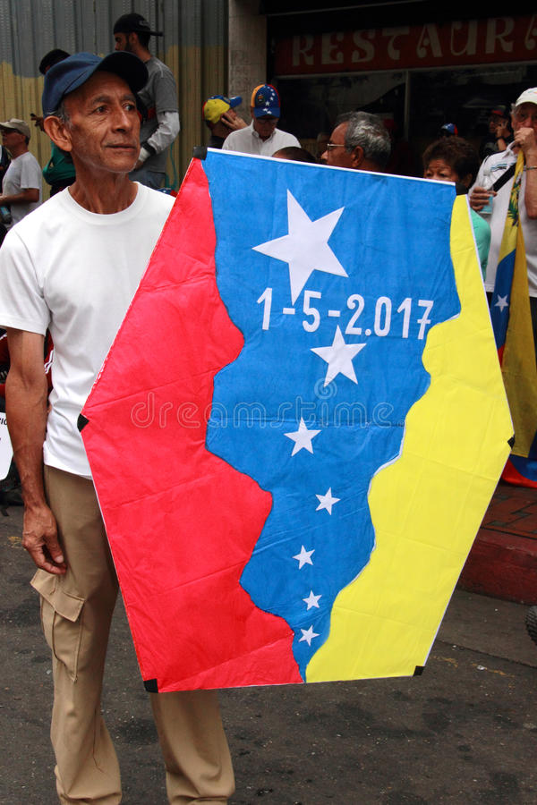 Famous Kite man Rafael Araujo with the Venezuelan flag during a opposition rally against Nicolas Maduro. May 2017 royalty free stock photo