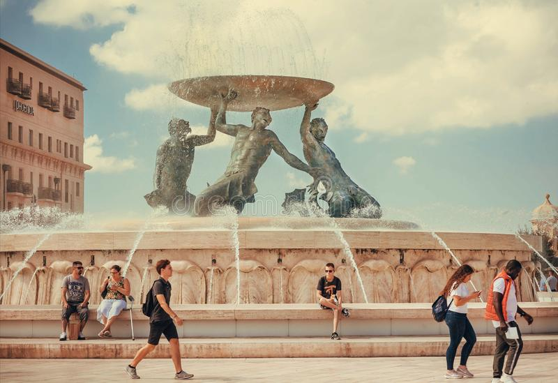 Famous landmark of islan, the Triton fountain and relaxing people around at hot sunny day stock photo