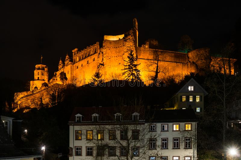 Illuminated heidelberg castle on hilltop at night. Famous landmarks in south west germany illuminated heidelberg castle on hilltop at night royalty free stock photography