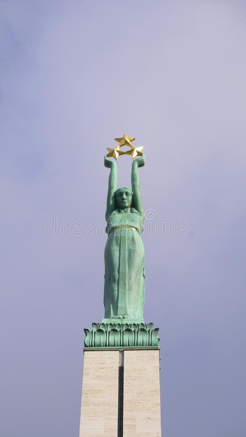 Famous landscape view of statue The Freedom Monument in Latvia Riga old town.  royalty free stock images