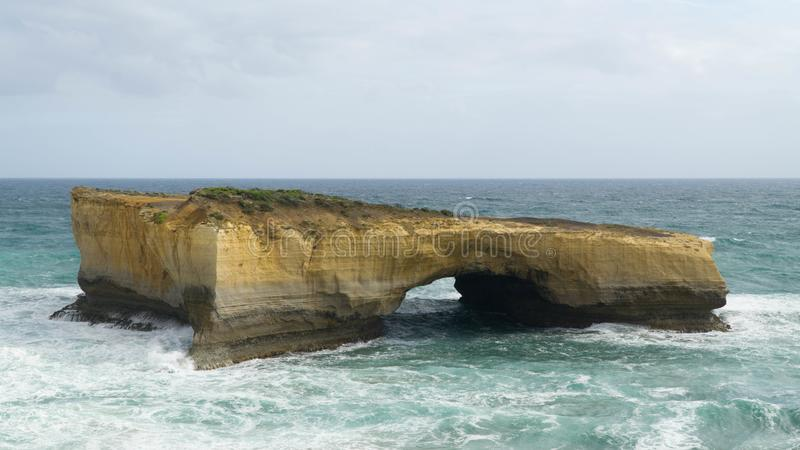 Famous London Arch - natural stone arch, one of many rock formations along The Great Ocean Road, Australia. Famous London Arch - natural stone arch, one of many royalty free stock photos