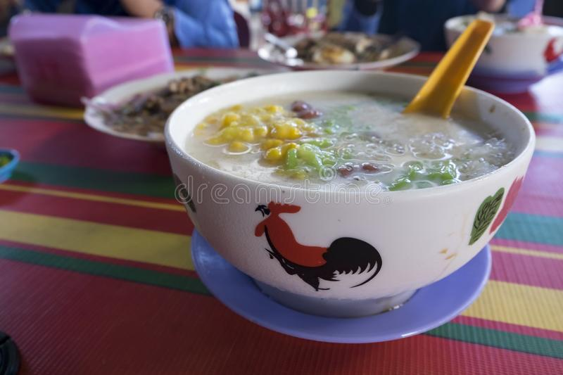 Famous Malaysian desserts called cendol. Red bean, sweet corn, r. Ice flour and other local ingredient mix together with coconut milk and ice royalty free stock photography