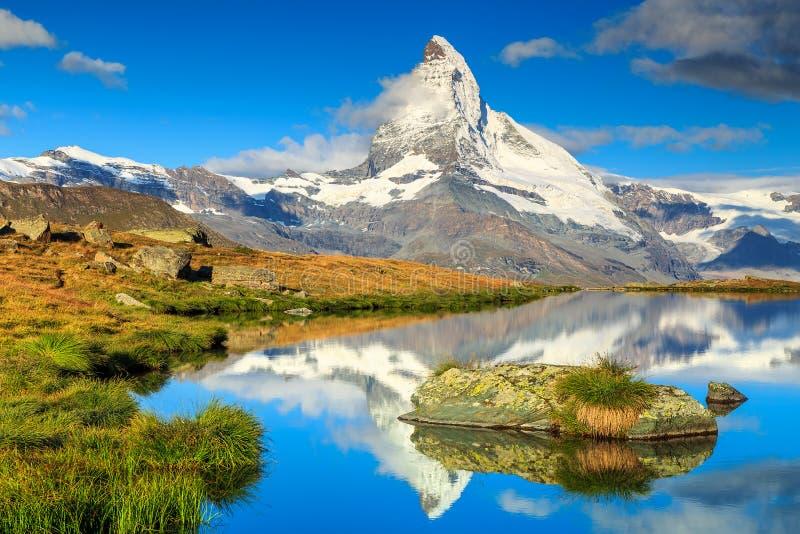 Famous Matterhorn peak and Stellisee alpine glacier lake,Valais,Switzerland. Stunning panorama with Matterhorn and beautiful alpine lake,Stellisee,Valais region stock photos