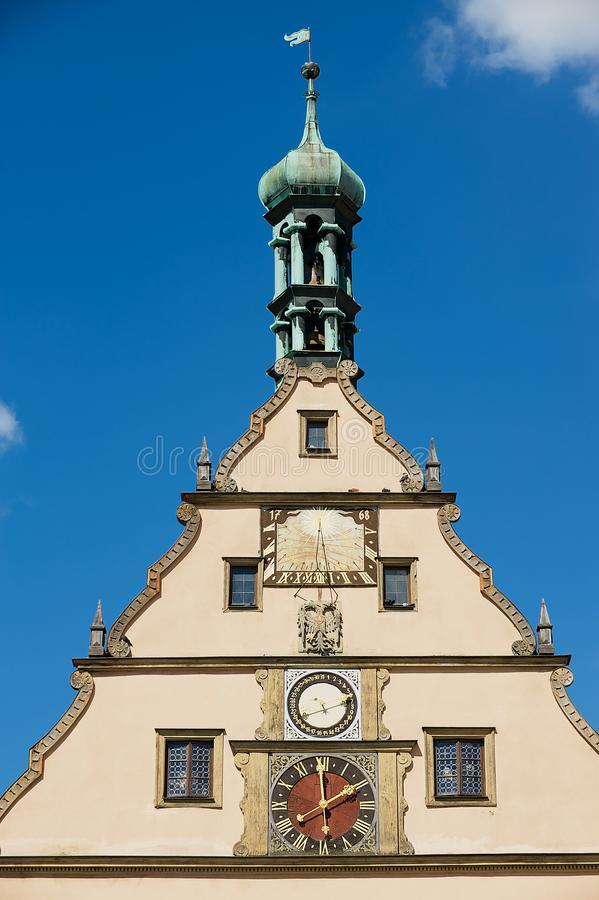 Famous medieval Meistertrunk mechanical clock at the historic town hall building in Rothenburg ob der Tauber, Germany. stock image