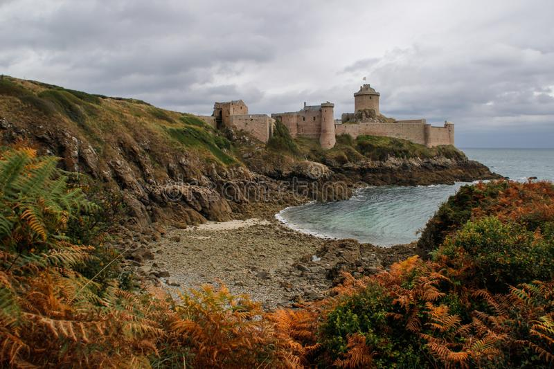 The famous medieval stone castle - fortress la Latte in the fall during a storm on the Celtic Sea in Normandy stock images