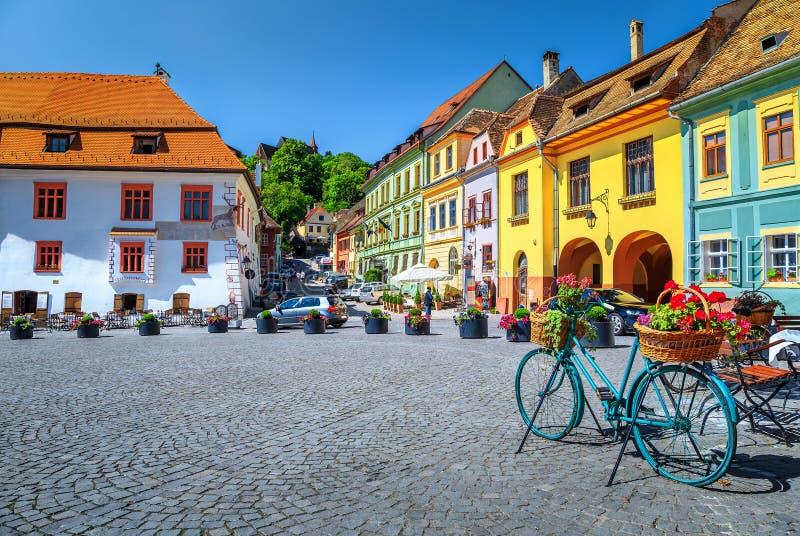 Famous medieval street cafe bar,Sighisoara,Transylvania,Romania,Europe stock photo