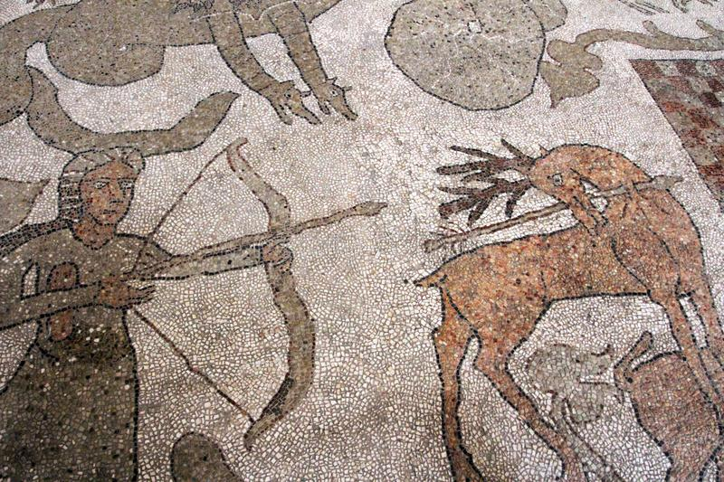 The famous mosaic of the Otranto Cathedral - hunting scene stock photography