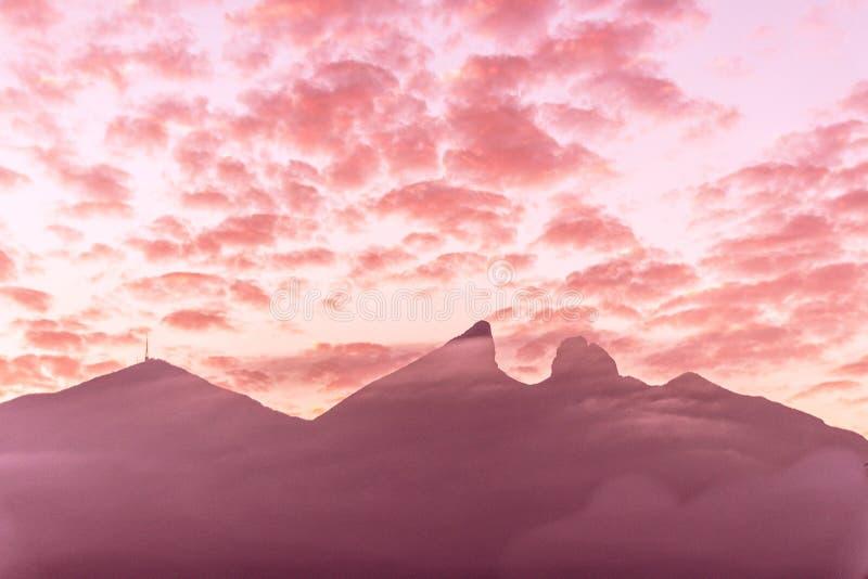 Famous mountain in Monterrey Mexico called Cerro de la Silla. Cerro de la Silla mountain silhouette in Monterrey Nuevo Leon Mexico stock photo