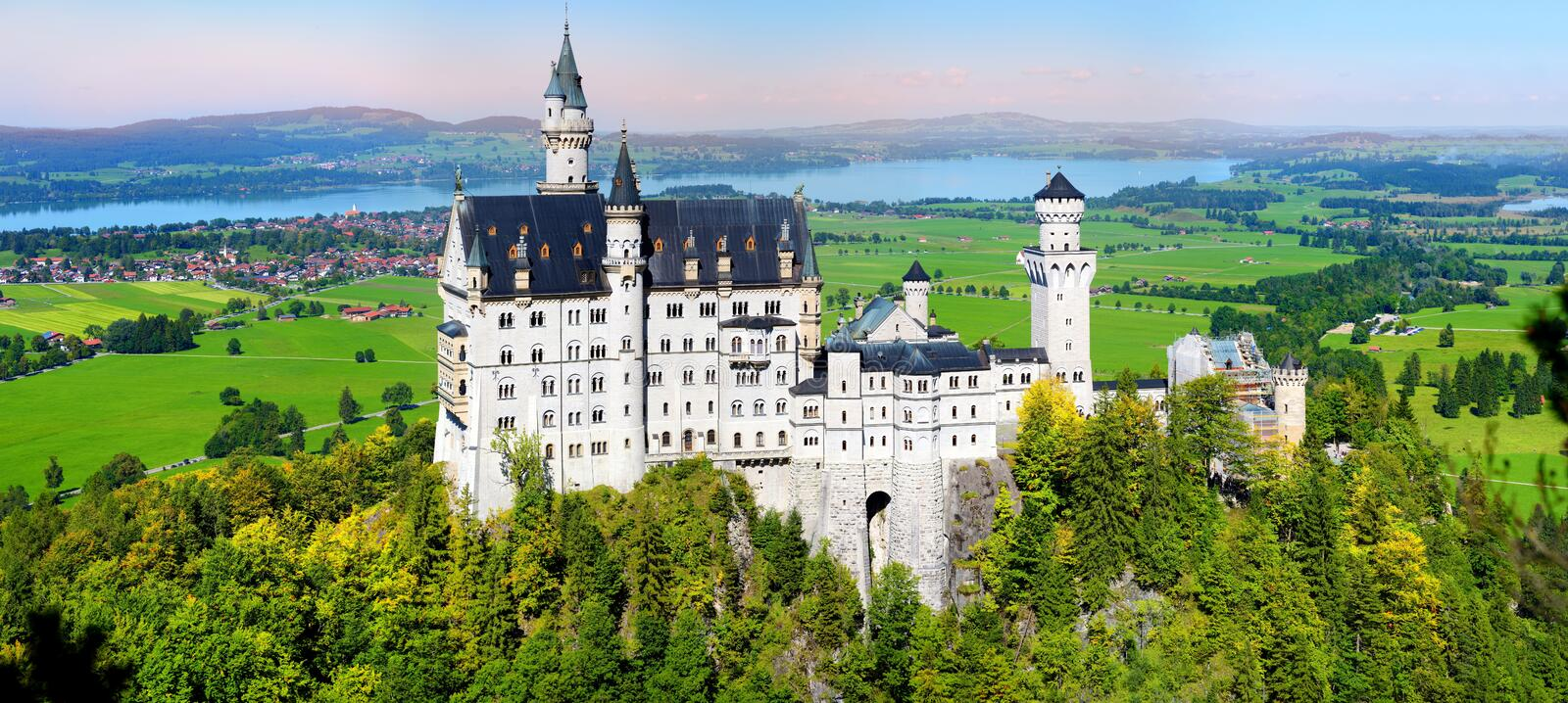 Famous Neuschwanstein Castle, fairy-tale palace on a rugged hill above the village of Hohenschwangau near Fussen stock photo