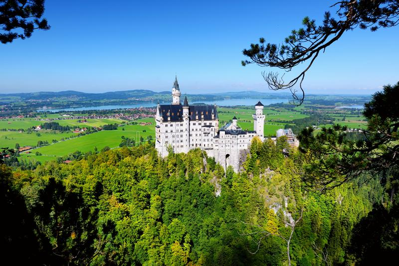 Famous Neuschwanstein Castle, 19th-century Romanesque Revival palace on a rugged hill above the village of Hohenschwangau in south royalty free stock photo
