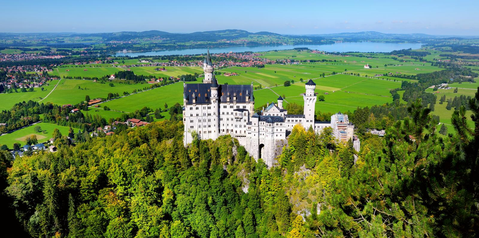 Famous Neuschwanstein Castle, 19th-century Romanesque Revival palace on a rugged hill above the village of Hohenschwangau in south stock image