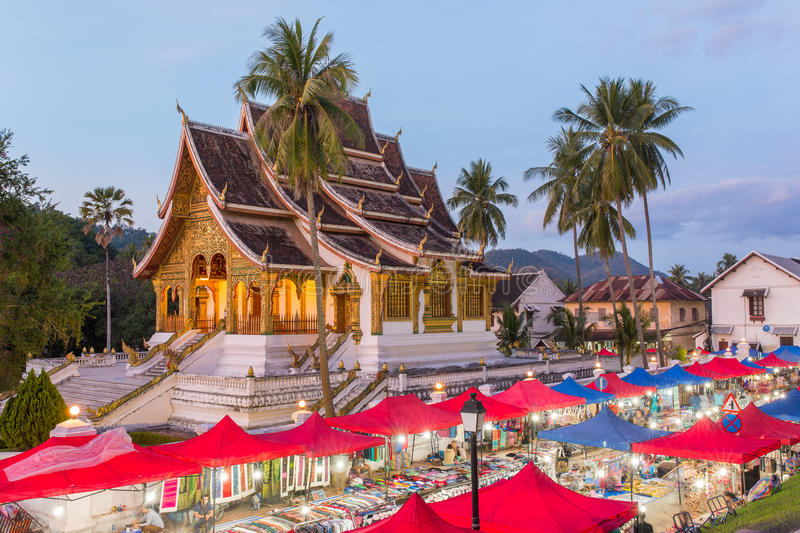 Famous night market and the Haw Pha Bang temple in Luang Prabang stock photography