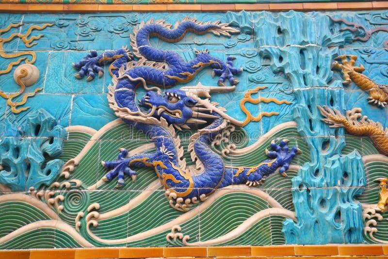 Famous Nine Dragon Panel Ancient Wall Beijing stock photo