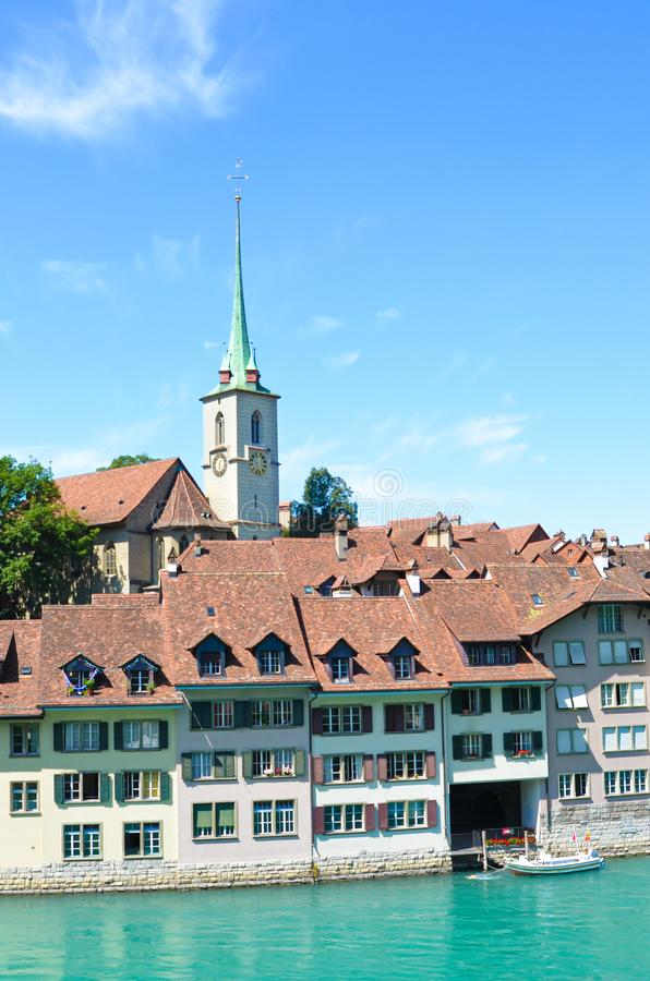 Famous Nydegg Church and historical center of the Swiss capital located along turquoise Aare River. Bern, Switzerland. stock photos