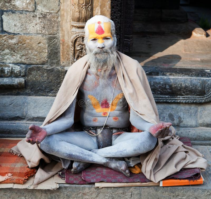 Famous painted sadhu (holy man) about Pashupatinath. KATHMANDU, NEPAL - DEC 16, 2013 Famous painted sadhu (holy man) about Pashupatinath - 16th of december 2013 royalty free stock photography