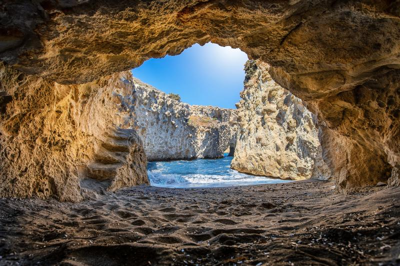 The Papafragkas caves and beach on the Greek island of Milos, Cyclades. The famous Papafragkas caves and beach formed by volcanic activity on the Greek island of royalty free stock images