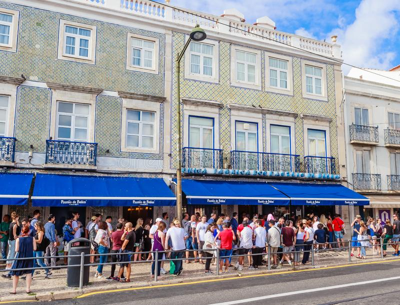 View of famous Pasteis de Belem – Egg Custard Tart - pastry shop in Lisbon. Clients wait on the street as the shop is always ful royalty free stock photos