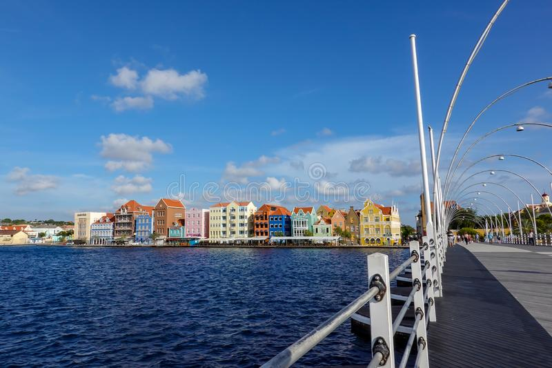 Famous pastel colored architecture and the Queen Emma floating bridge of Curacao island royalty free stock photos
