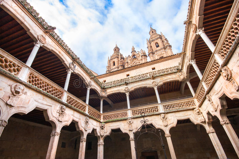 Famous Patio de la Casa de las Conchas with La Clerecia Church in Salamanca, Castilla y Leon, Spain royalty free stock photography