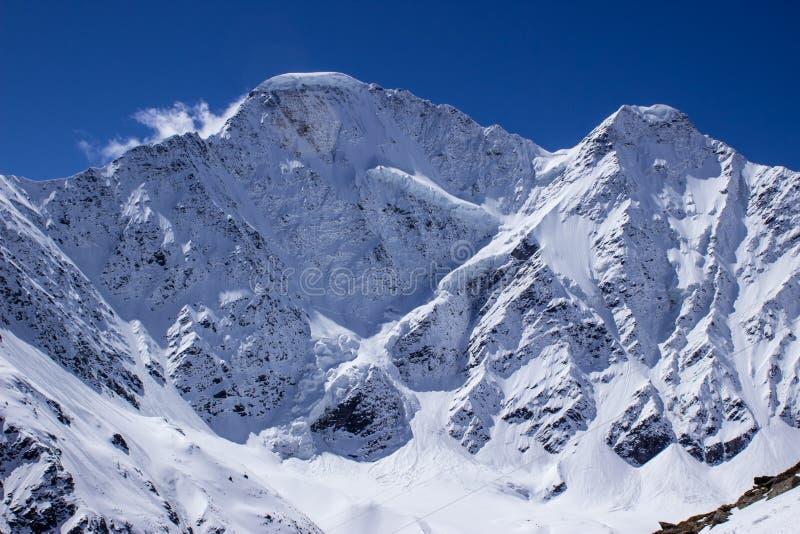Famous peak Seven close-up under blue sky. Snowbound famous peak Seven close-up under blue sky royalty free stock images