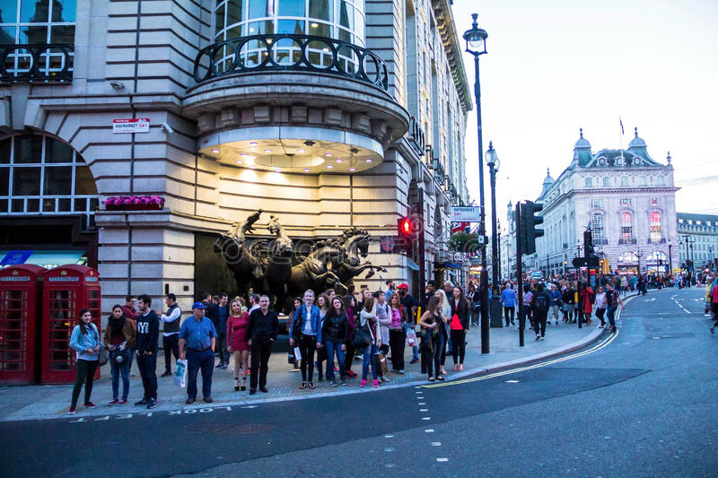 Famous Piccadilly Circus , one of major attraction of London, with Four Bronze Horses of Helios. Tourists visit famous Piccadilly Circus that has become one of royalty free stock photo