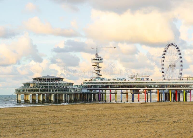 The famous pier jetty of Scheveningen beach the hague a popular touristic hot spot in the Netherlands. The famous well-known pier jetty of Scheveningen beach the stock photos