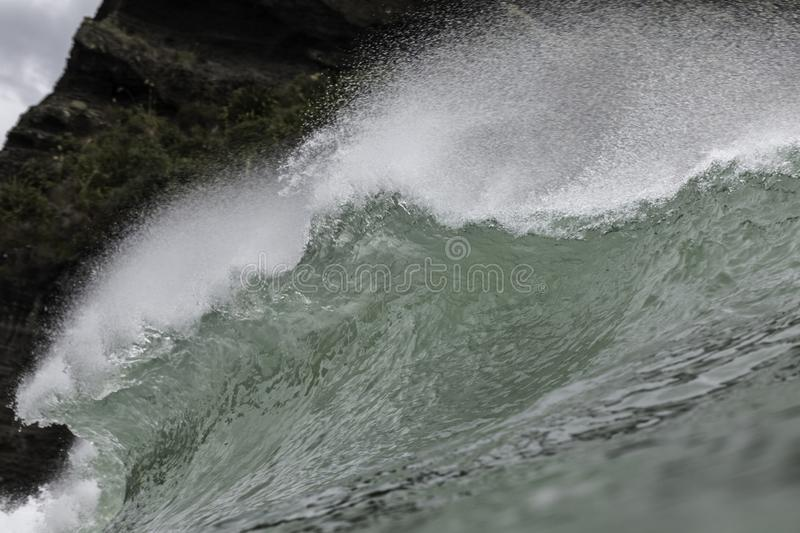 Surf at Piha Beach, NZ. Famous Piha surf, one of NZ`s most iconic surfing beaches showing great form stock image