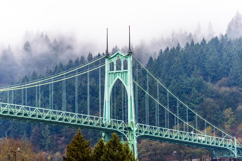 Famous popular arched gothic St Johns bridge in Portland Oregon. The large famous gothic arched transportation and pedestrian St Johns bridge across the royalty free stock photography