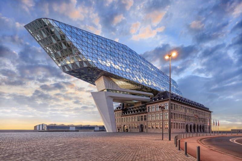 The  famous Port of Antwerp headquarters against a dramatic sky at twilight, Antwerp, Belgium. ANTWERP-FEB. 15, 2019. Port House Antwerp at dusk. Zaha Hadid stock image