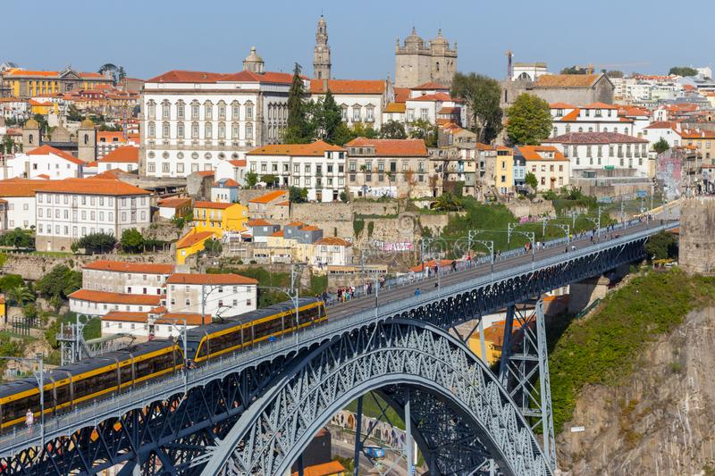 Famous Porto bridge Ponte Luis with yellow train top view. Metro bridge with train. Urban transportation concept. Porto, Portugal - 10/20/2019: Famous Porto royalty free stock photos