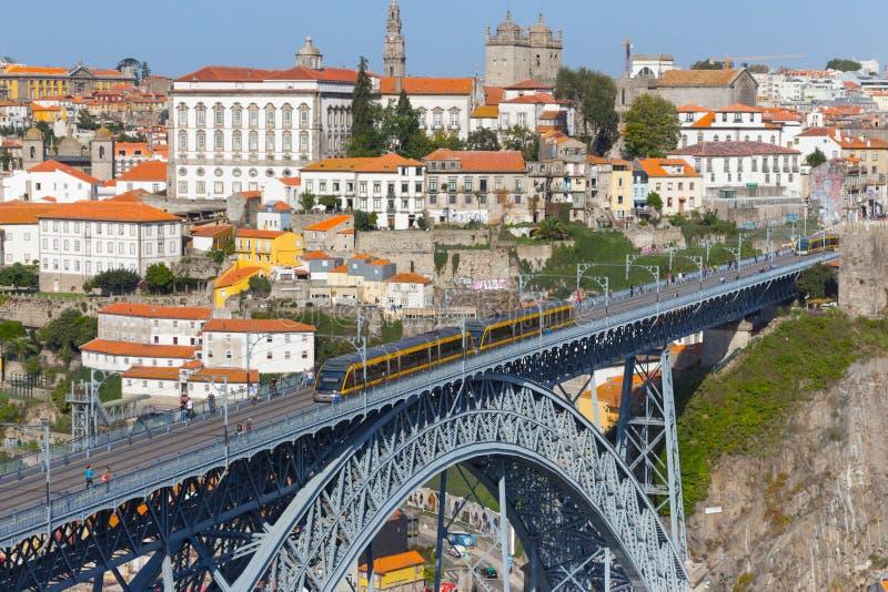 Famous Porto bridge Ponte Luis with yellow train top view. Metro bridge with train. Urban transportation concept. royalty free stock photography