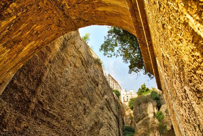 Famous Puente Nuevo Bridge Arch in Ronda historic city center. Spain, Ronda, scenic Puente Nuevo Arch Puente Nuevo Bridge stock photo