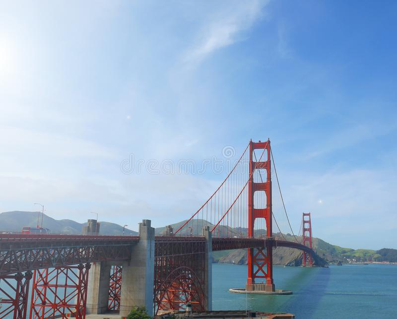 Famous red suspension Golden Gate Bridge in San Francisco, USA, on sunny day. The landmark is a must visit tourist spot for travelers visiting California stock image
