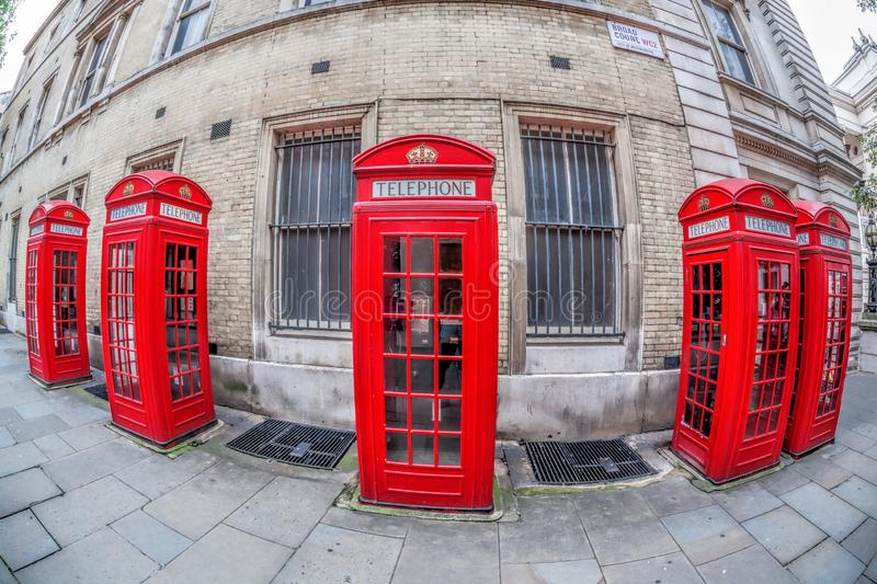 Famous red telephone booths in Covent Garden street, London, England. Red telephone booths in Covent Garden street, London, England royalty free stock photography