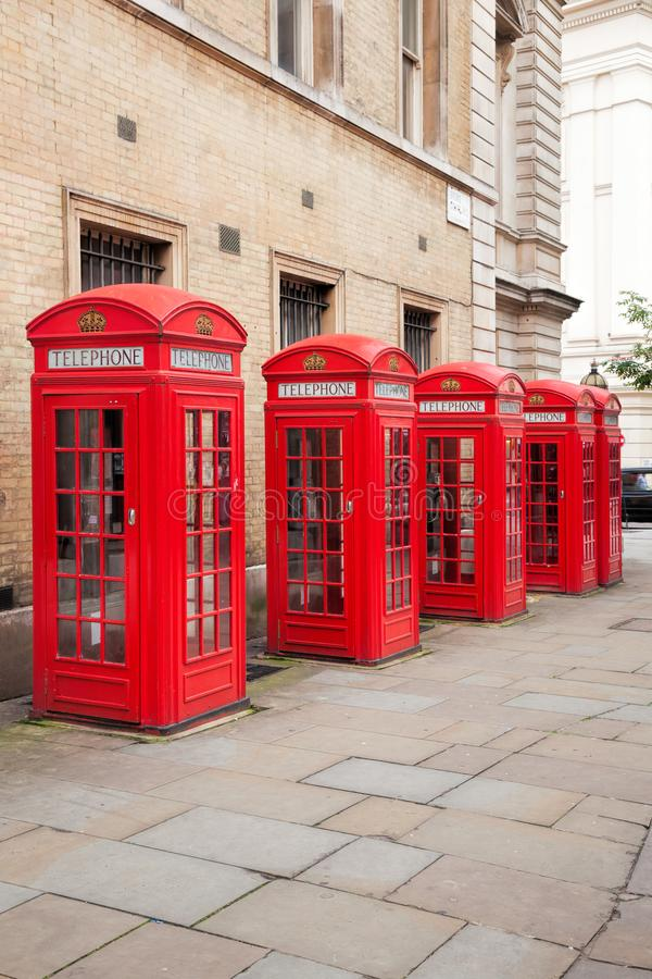 Famous red telephone booths in Covent Garden street, London, England. Red telephone booths in Covent Garden street, London, England royalty free stock photos