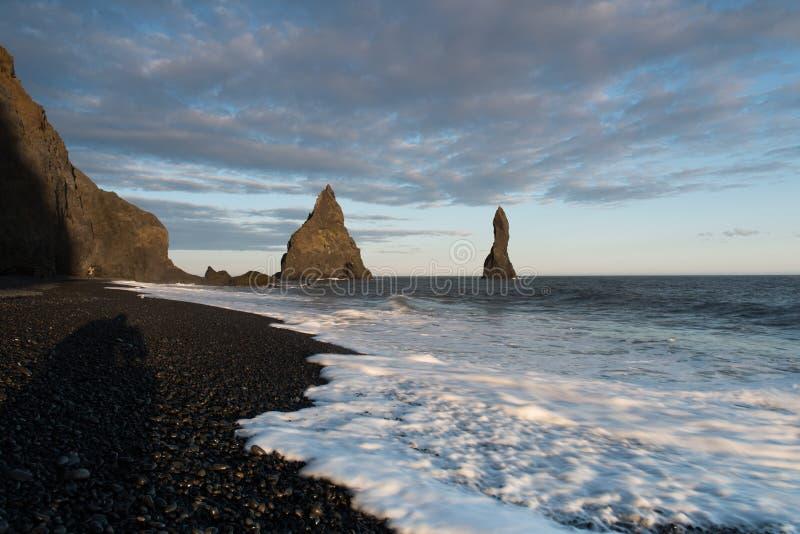 Famous Reynisdrangar rock formations at black Reynisfjara Beach. Coast of the Atlantic ocean near Vik royalty free stock photo