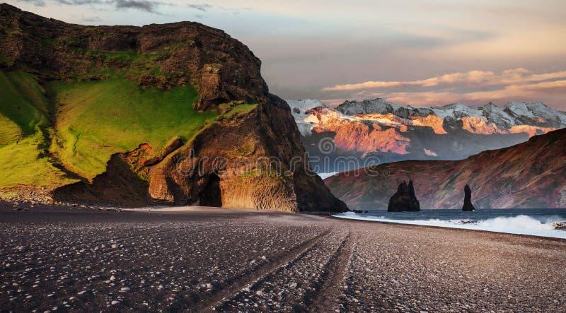 Famous Reynisdrangar rock formations at black Reynisfjara Beach. Coast of the Atlantic ocean near Vik, southern Iceland stock photography