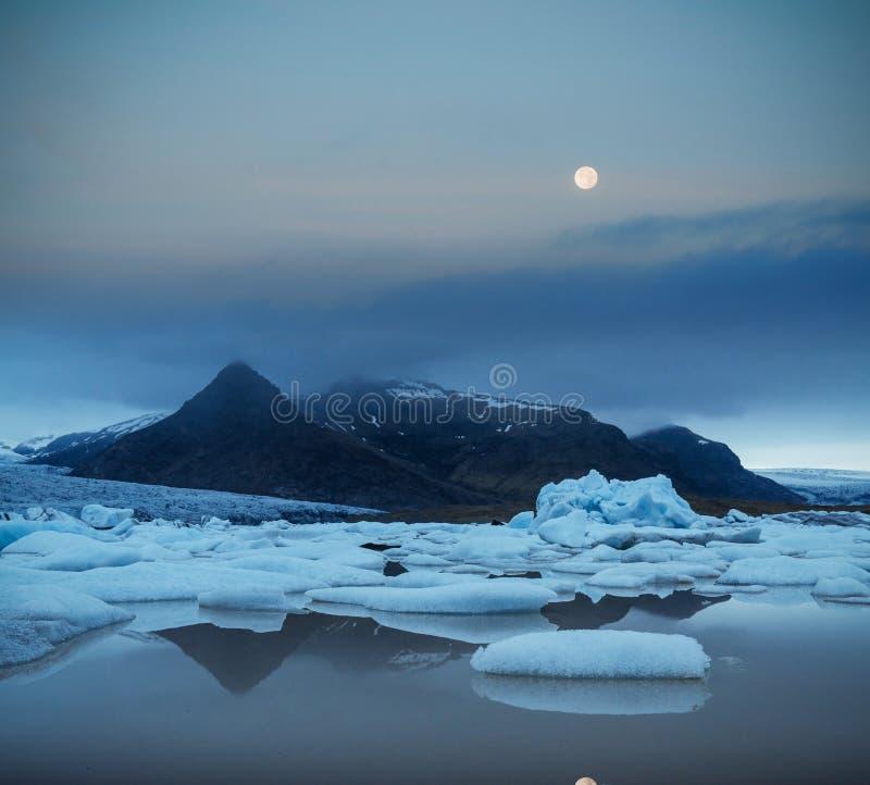 Famous Reynisdrangar rock formations at black Reynisfjara Beach. Coast of the Atlantic ocean near Vik, southern Iceland.  stock photo