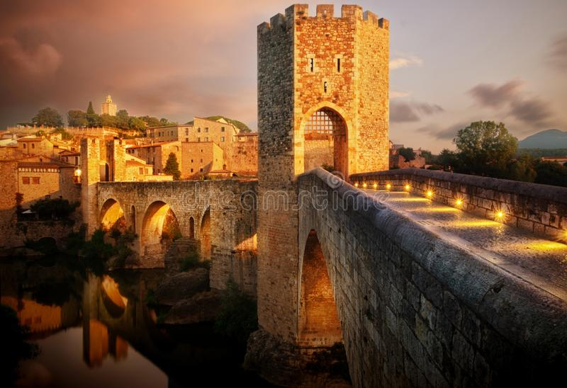 Famous Romanesque Bridge in Besalú, Catalonia, Spain during sunset royalty free stock photos