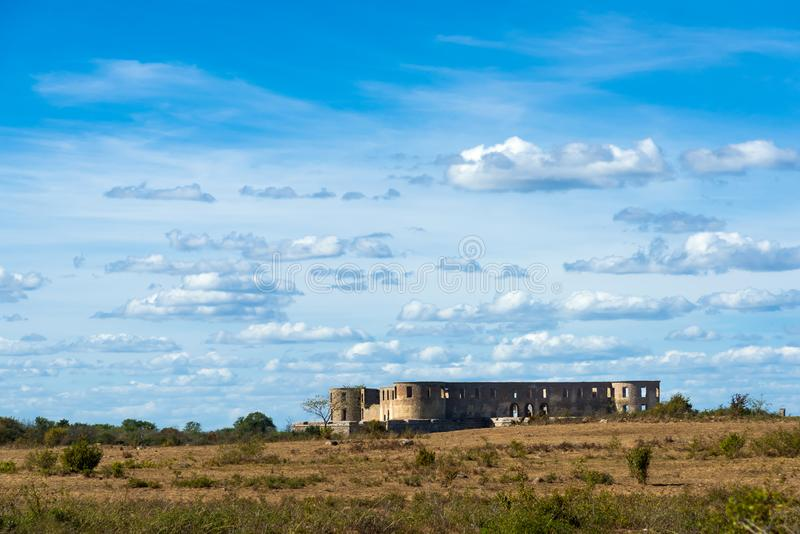 The ruins of Borgholm Castle. The famous ruin of Borgholm Castle on the swedish island of Oeland, on a warm summer day, seen seen from a distance stock image