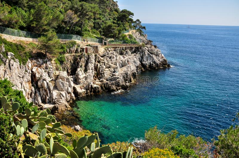 Famous Saint-Jean-Cap-Ferrat bay at French Riviera. Provence-Alpes-Côte d`Azur department in southeastern France. Private small. Rocky beaches with turquoise stock image